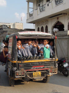 children packed into a taxi